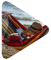 Child in a hammock on a beach